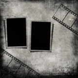 Blank photo frames and film strip. Vintage artistic background with Blank photo frames and film strip on the old paper Royalty Free Stock Photography