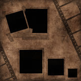 Blank photo frames and film strip. Vintage artistic background with Blank photo frames and film strip on the old paper Royalty Free Stock Images