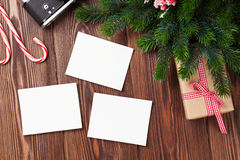Blank photo frames with gift, pine tree and camera Royalty Free Stock Images