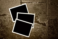Blank photo frames on grunge background Stock Photo