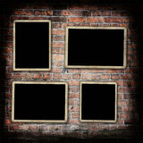 Blank photo frames on grunge wall royalty free stock photo