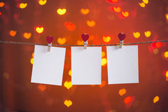 Blank photo frames hanging on the heart clothesline Stock Image