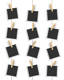 Blank photo frames hanging vertically with clothespin Stock Images