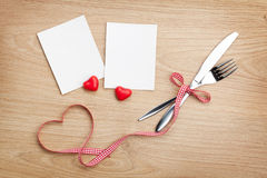Blank photo frames with heart candy and silverware Stock Photography