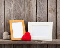 Blank photo frames and heart gifts Royalty Free Stock Photos