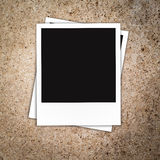 Blank photo frames on notice board Stock Photos