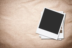 Blank photo frames on old paper background. Stock Photography