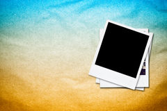 Blank photo frames on old paper background. Royalty Free Stock Images