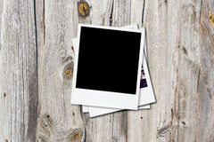 Blank photo frames on old wooden background. Stock Photography