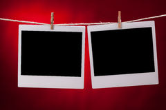 Blank photo frames on red background Royalty Free Stock Photos