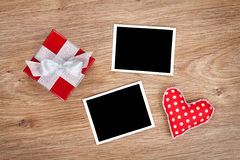 Blank photo frames and small red gift box Stock Image