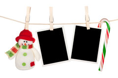 Blank photo frames and snowman hanging on the clothesline Stock Image