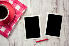 Blank photo frames on table Stock Images