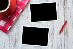 Blank photo frames on table Royalty Free Stock Photo
