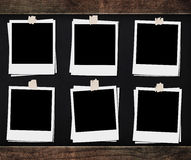 Blank photo frames with tapes, on blackboard backgrounds with wooden frame. Blank photo frame with tapes, on blackboard backgrounds with wooden frame Royalty Free Stock Photos