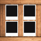 Blank photo frames on wood background Royalty Free Stock Image