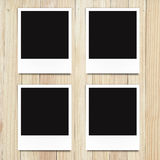 Blank photo frames on wood background Stock Images