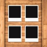 Blank photo frames on wood background Stock Photo