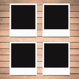 Blank photo frames on wood background Stock Photos