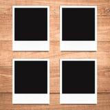 Blank photo frames on wood background Royalty Free Stock Image