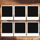 Blank photo frames on wood background Stock Image