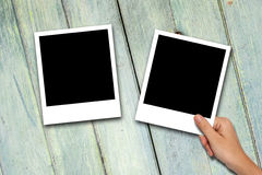 Blank photo frames on wood background Royalty Free Stock Images