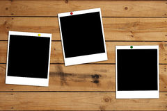 Blank photo frames on wooden background Royalty Free Stock Photography