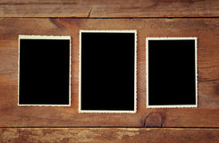Blank photo frames on wooden background. Top view of blank photo frames on wooden background stock images