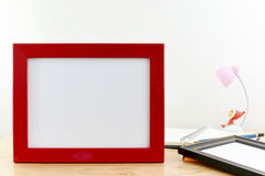Blank photo frames on wooden table and white background. Royalty Free Stock Images