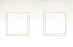 Blank photo frames on wooden white clolred wall Royalty Free Stock Photos