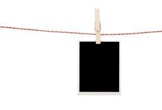 Blank photo hanging on clothesline Stock Photo
