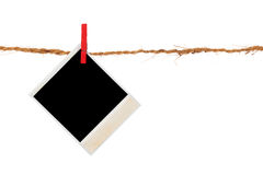 Blank photo hanging on a clothesline. Over white background Royalty Free Stock Image