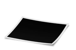 Blank photo lying on white surface in perspective. Rendered blank photograph isolated on white surface pictured from angle. (Clipping path for easier picture Royalty Free Stock Images