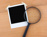 Blank photo and magnifier royalty free stock photos