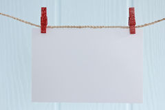 Blank photo paper. Hanging on a rope stock photography