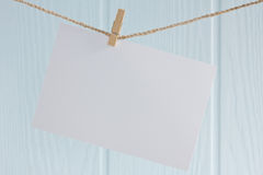 Blank photo paper. Hanging on a rope stock images