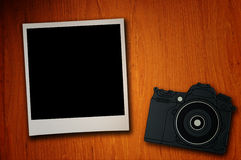 Blank photo paper and camera Stock Image