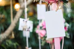 Hang blank photo paper card at wedding room royalty free stock photography