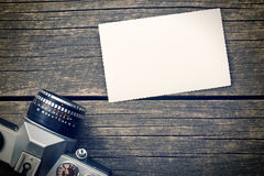 Blank photo paper and retro camera Stock Photo