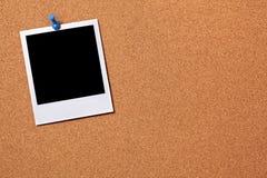 Blank polaroid photo print frame, cork background, copy space Stock Images