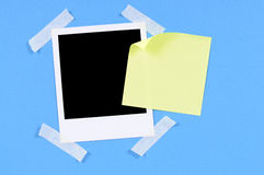 Blank polaroid frame photo print yellow sticky note Royalty Free Stock Images