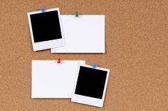 Polaroid frames blank paper index cards cork background copy space Royalty Free Stock Image