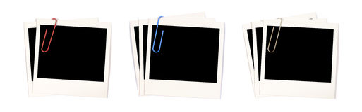 Polaroid photo frames stack paperclips Royalty Free Stock Photos