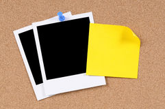 Polaroid photo frames yellow post-it style sticky note cork board Royalty Free Stock Photos