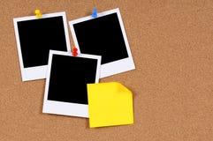 Polaroid photo frames sticky note cork background copy space Stock Photo