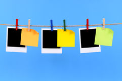 Polaroid photo frames with post it style sticky notes string rope washing line Stock Photo