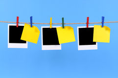 Polaroid frame photo prints, post it style sticky notes rope washing line Stock Images