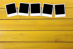 Blank polaroid photo frame prints row wood table background copy space Royalty Free Stock Images