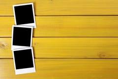 Row polaroid frame photo prints wood table background copy space Stock Photo
