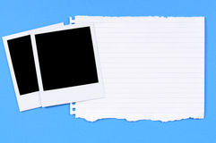 Two polaroid photo frames torn writing paper Royalty Free Stock Photo